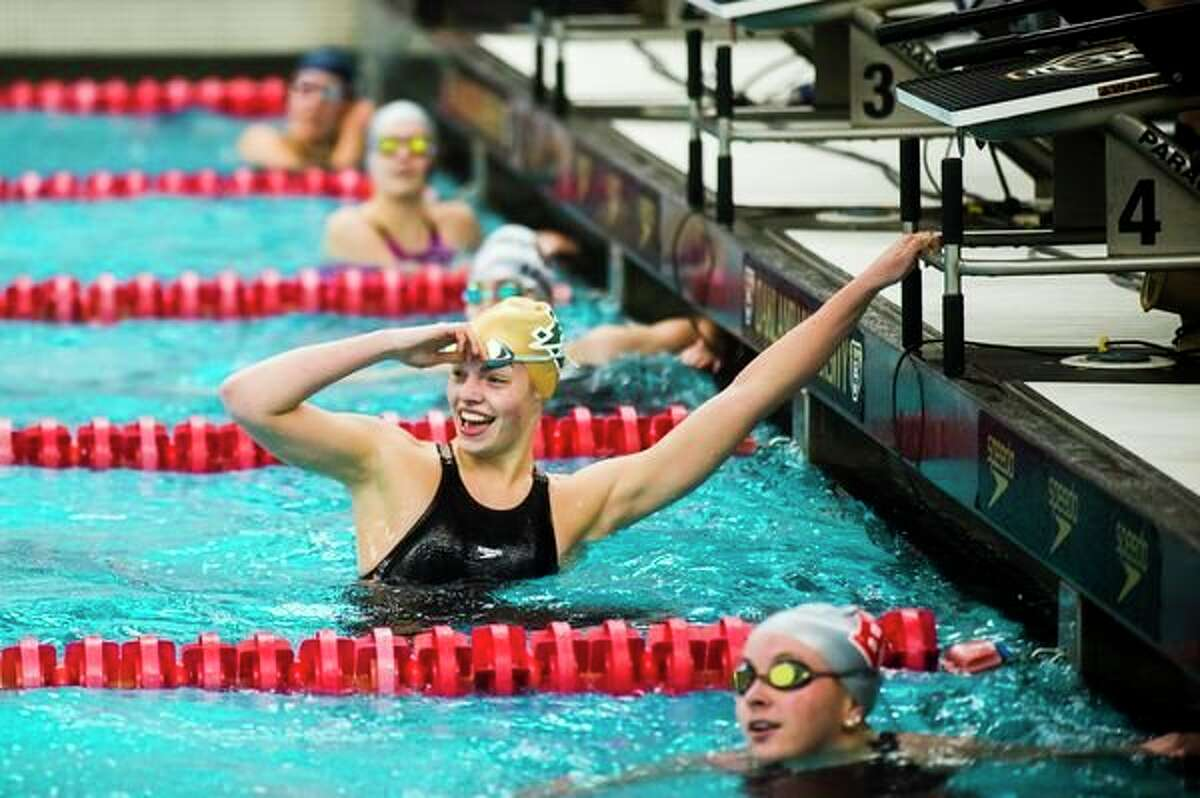 Dow High's Claire Newman checks her time after winning the 50-yard freestyle at the Nov. 23, 2019 Division 2 state finals.
