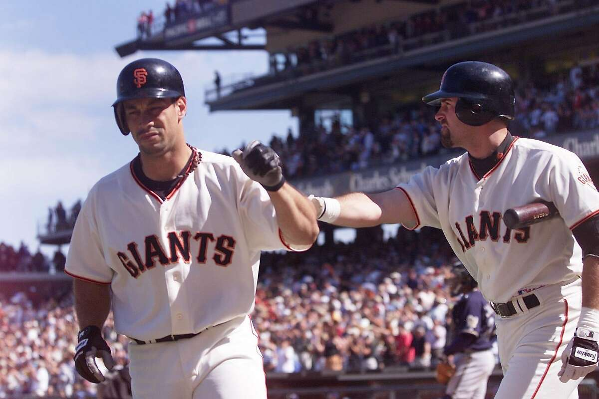 GIANTS09B-C-08JUL01-SP-KL --- Giants Felipo Crespo gets a 'good job' pat from Rich Aurilia after Crespo hit a homer in the in the 9th inning sending the game in extra innings, during the 4 hour and 37 minute game against the Milwaukee Brewers, the Brewers won 6-4 in the 13th inning. (KENDRA LUCK/SAN FRANCISCO CHRONICLE)