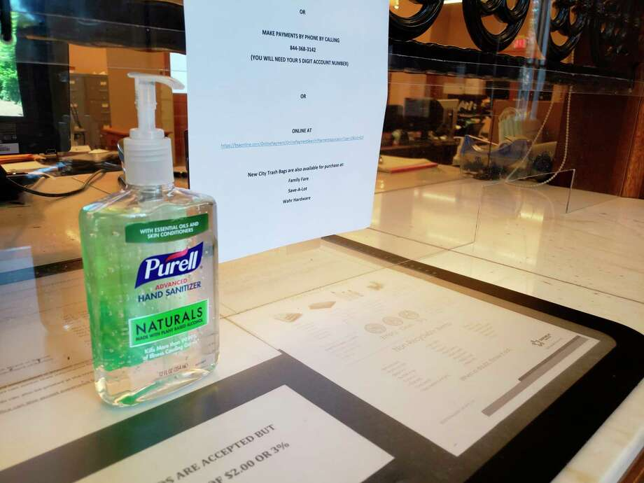 The customer service counters at Manistee City Hall feature plastic glass barriers and hand sanitizer. (Arielle Breen/News Advocate)