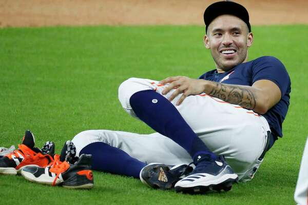 Houston Astros shortstop Carlos Correa lounges between drills during the Astros summer camp at Minute Maid Park, Tuesday, July 7, 2020, in Houston.