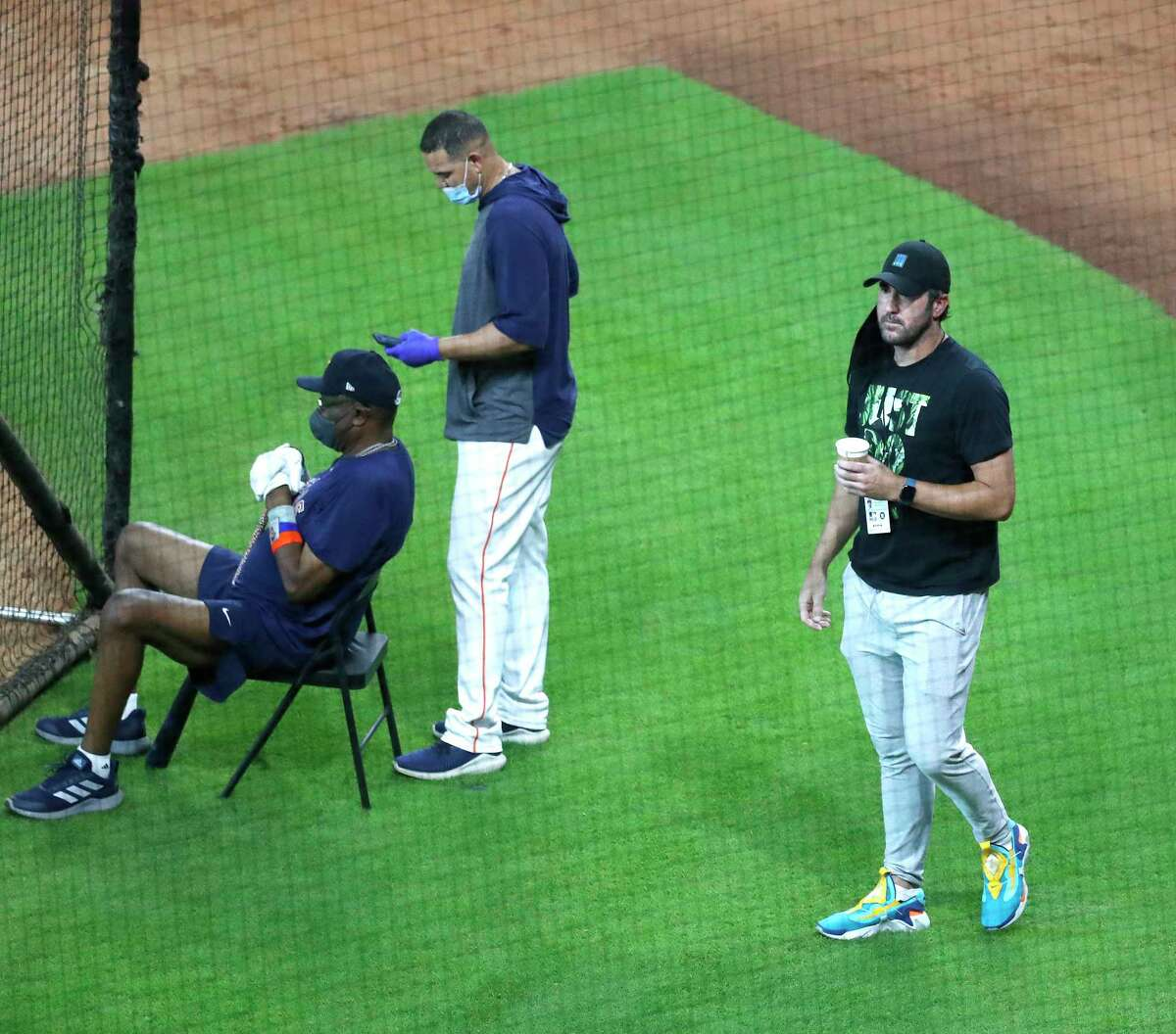 Houston Astros pitcher Justin Verlander wearing a mask and street clothes watches a live batting practice session during the Astros summer camp at Minute Maid Park, Tuesday, July 7, 2020, in Houston.