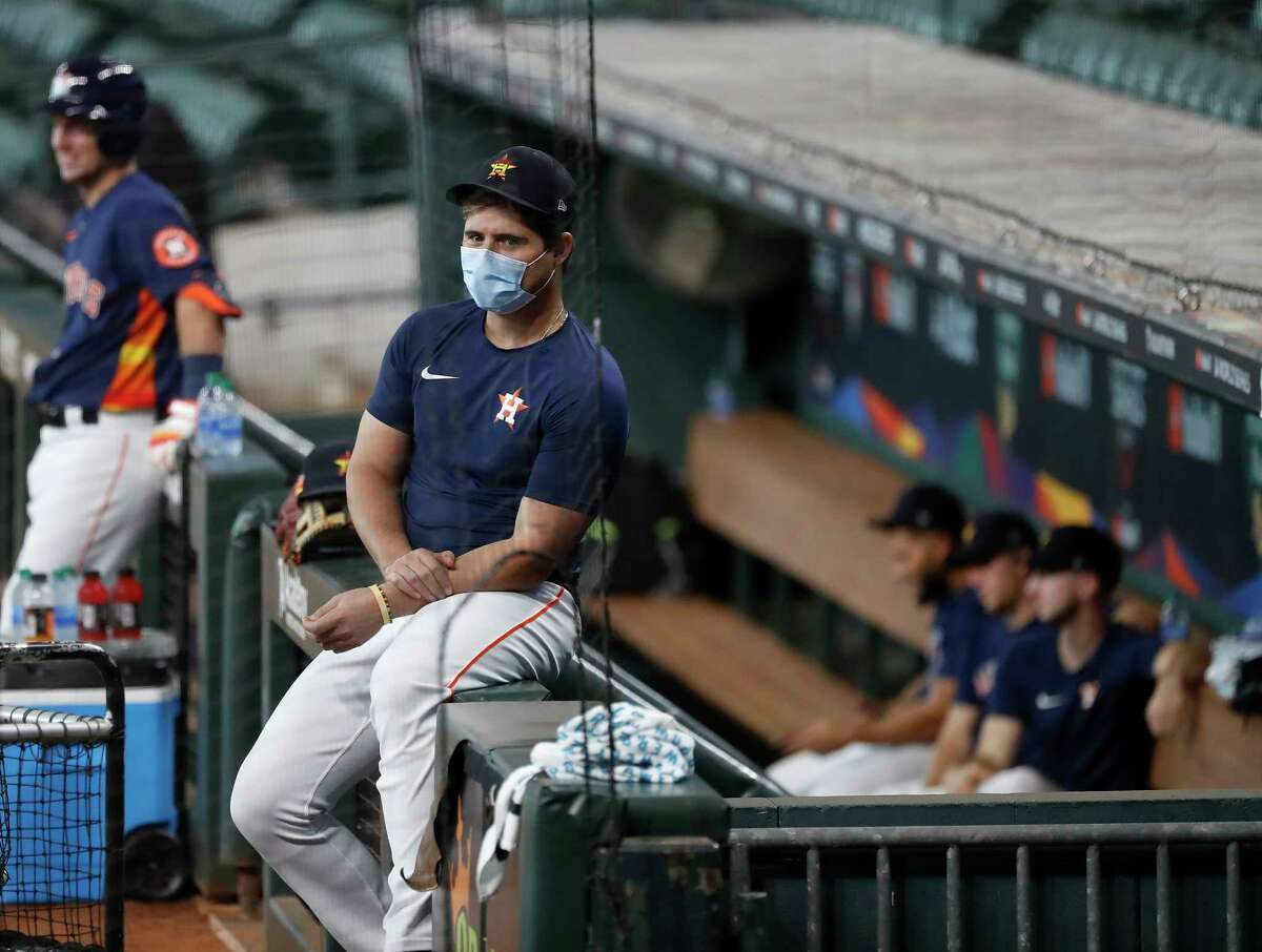 Houston Astros infielder Aledmys Diaz watches live batting practice wearing a mask during the Astros summer camp at Minute Maid Park, Tuesday, July 7, 2020, in Houston.