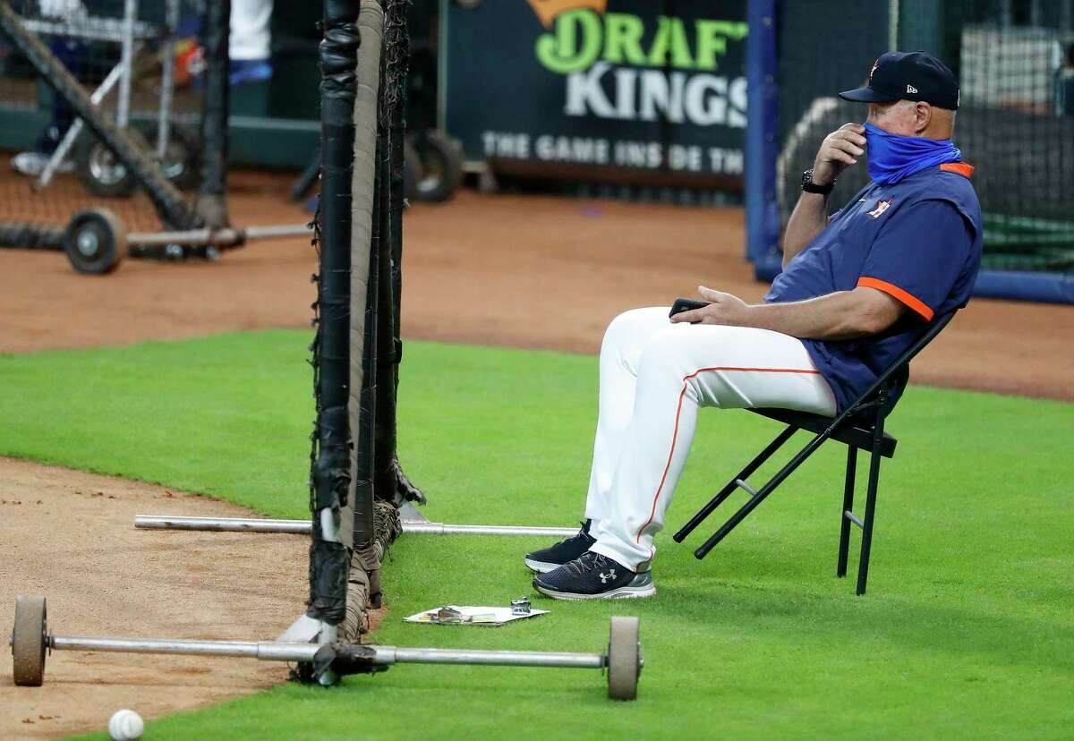 Houston Astros pitching coach Brent Strom watches pitcher Ryan Pressly from behind the catcher as he threw live batting practice during the Astros summer camp at Minute Maid Park, Tuesday, July 7, 2020, in Houston.