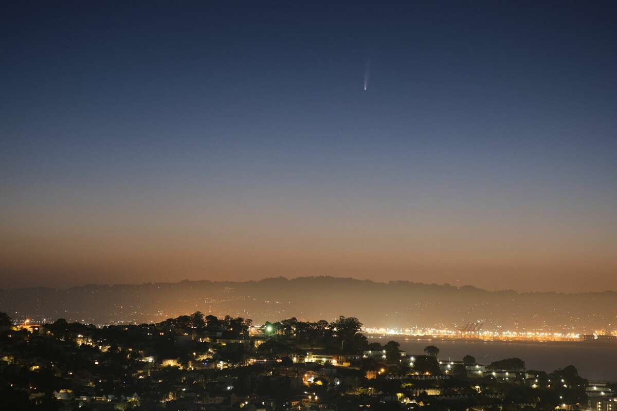 Comet Neowise is viewable by the naked eye in the early morning above the East Bay hills from San Francisco, Calif. on July 7, 2020.