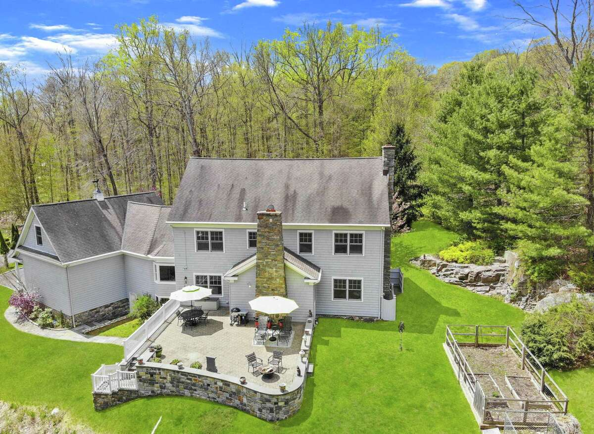 In the backyard there is a large raised paving stone patio and fenced vegetable garden. The listing agent calls this house and its three-acre property: