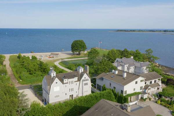 This house is only steps from a private community beach for residents of Saugatuck Island.