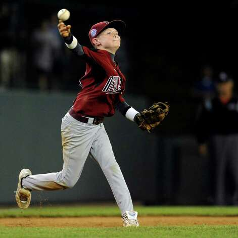 Tommy Ryan throws to first during Tuesday's game in the Little League World Series in Williamsport, Pennsylvania. Photo: Lindsay Niegelberg / Connecticut Post