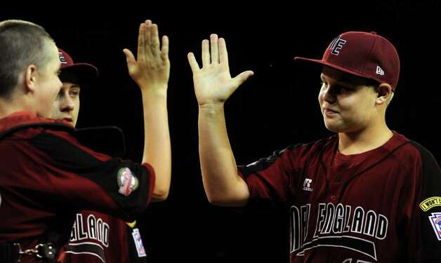 Fairfield American little leage teammates exchange high-fives before Tuesday's game against Northwest in the Little League World Series in Williamsport, Pennsylvania. Photo: Lindsay Niegelberg / Connecticut Post