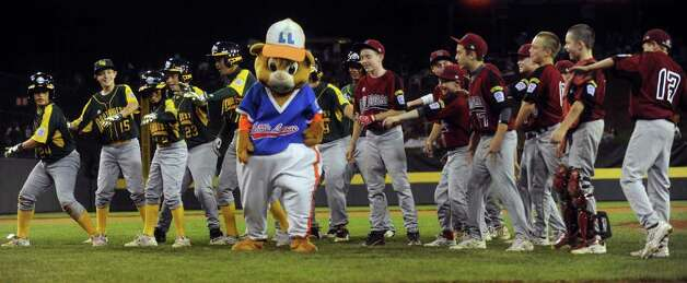 Members of the Fairfield American little league show off their dance moves with mascot Dugout before Tuesday's game against Northwest in the Little League World Series in Williamsport, Pennsylvania. Photo: Lindsay Niegelberg / Connecticut Post