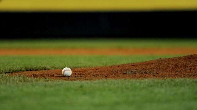 A baseball sits at the edge of the pitcher's mound at Lamade Stadium during Tuesday's game in the Little League World Series in Williamsport, Pennsylvania. Photo: Lindsay Niegelberg / Connecticut Post