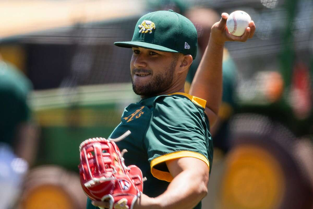Oakland A's Vimael Machin practices during an Oakland A's training camp workout at O.Co Coliseum in Oakland, Calif. Tuesday, July 7, 2020. Due to COVID-19, the 2020 MLB season has been postponed with players just beginning to return for warmups and practices while wearing masks and keeping social distance.