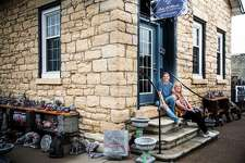 Jersey County native Kimberly Dublo, left, who, along with her mother, Brenda Dublo, right, of Grafton, sit outside their new business, Lady LaMarsh Gallery & Gifts LLC., at 25 E. Main St., in Grafton. The gallery and specialty gifts store is inside the historic LaMarsh House, thereby reserving a piece of Grafton's heritage while promoting regional artists and providing a marketplace for their works. A variety of landscaping and lawn art are available on-site and on view, including gazing balls and detailed outdoor ornamental concrete sculpture.