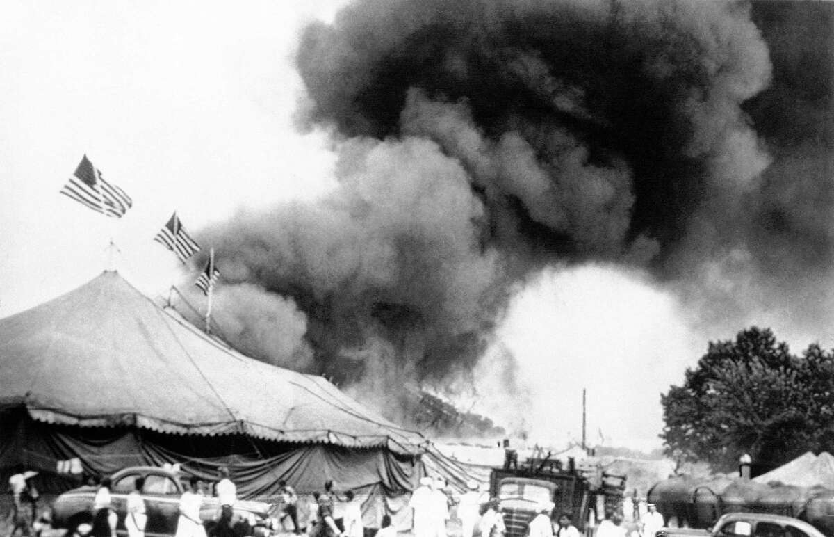 In this July 6, 1944, file photo, people can be seen fleeing a fire in the big top of the Ringling Brothers and Barnum and Bailey Circus in Hartford, Conn.
