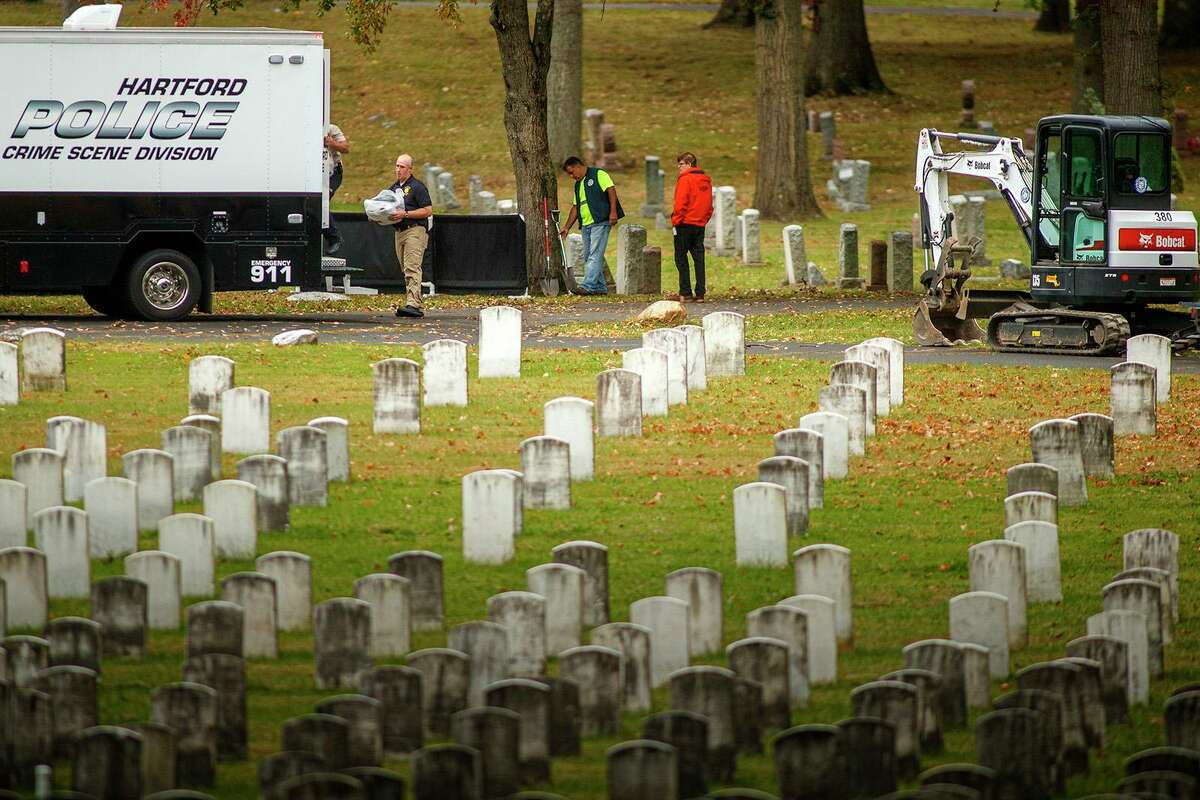 File photo showing officials from the Hartford Police Department as they prepared to exhume two unidentified victims of the 1944 circus fire in Hartford, Conn. The victims were interred in Windsor's Northwood Cemetery in Windsor, Conn. Photo taken on Oct. 7, 2019.