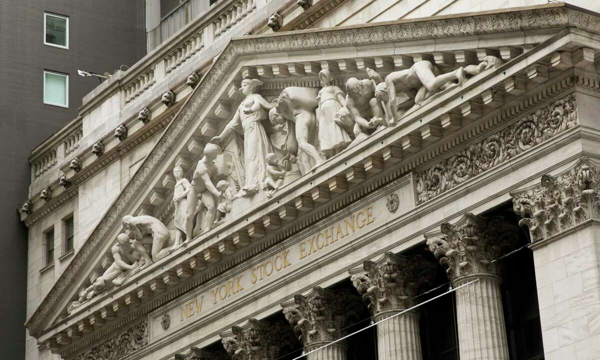 FILE - This June 30, 2020, file photo, shows the facade of the New York Stock Exchange. (AP Photo/Mark Lennihan, File)