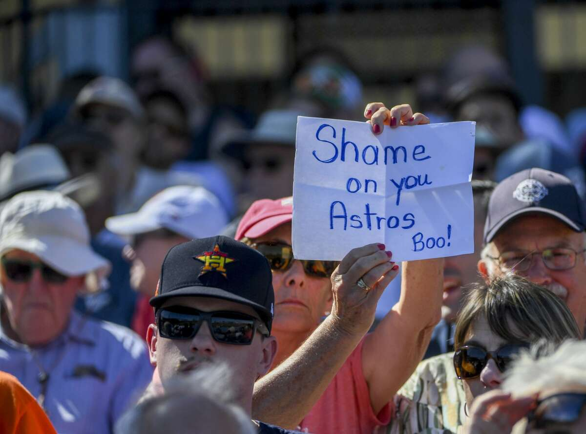 A fan holds a sign during spring training action between the Houston Astros and Washington Nationals at the Ballpark of the Palm Beaches.