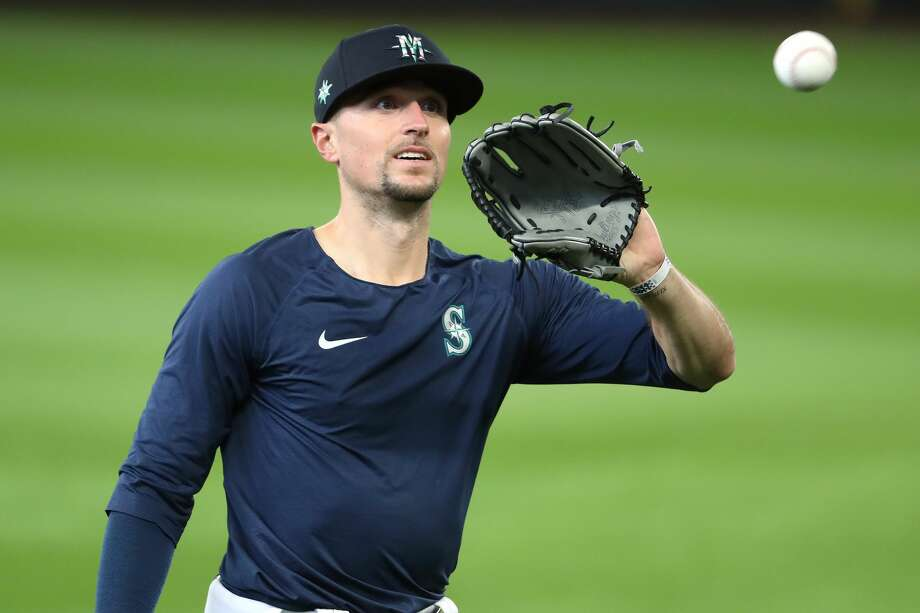Mariners outfielder Braden Bishop will be wearing cleats inspired by local burger chain Dick's Drive-In, with the $1,000 gift certificate he recoups as part of his agreement with the franchise to be used to feed Washington firefighters. Photo: Abbie Parr/Getty Images / 2020 Getty Images