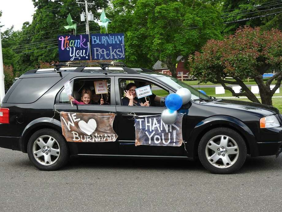 The Toczylowski family from Burnham School in Bridgewater sends a heartfelt message to teachers as they participate in the parade. Photo: Courtesy Of Burnham School / Danbury News Times Contributed