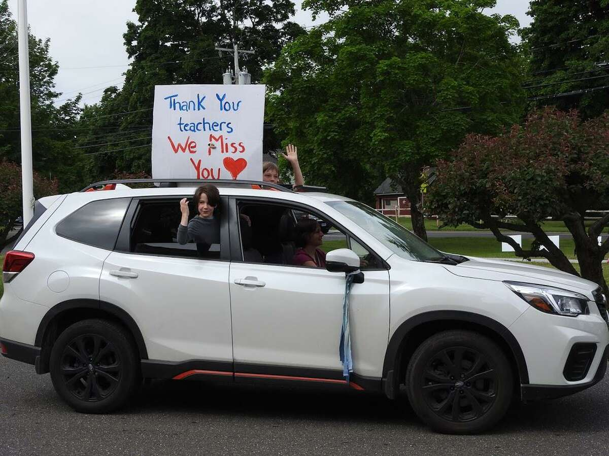 Burnham School's Hill family cheers on the teachers and other staff during the parade.