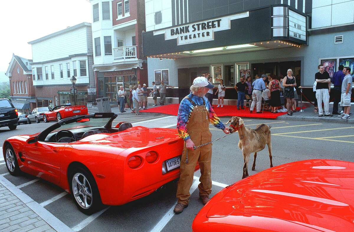 Former New Milford Film Commission chairman Frank Weller and friend Ezra the goat take a stroll along Bank Street on the occasion of the screenings of