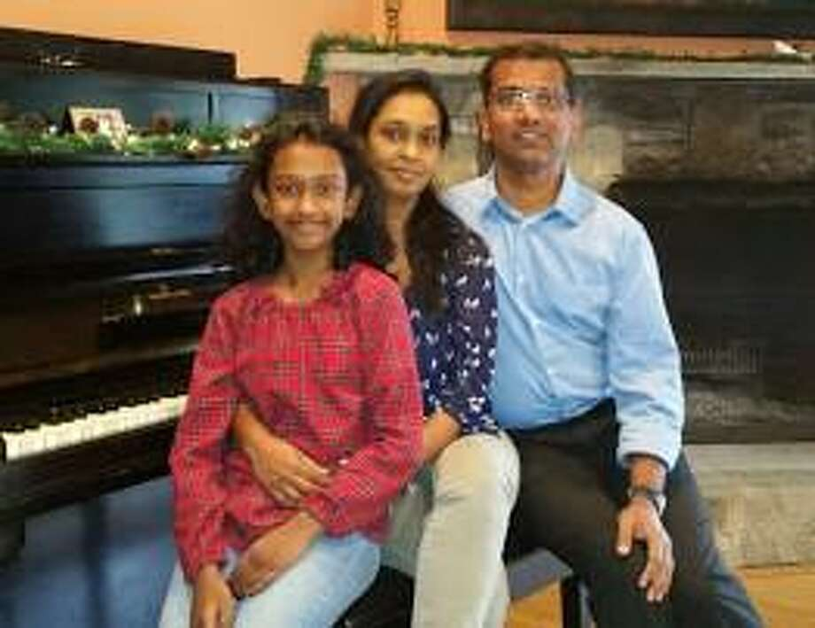 The Rev. Jitesh Immanuel Soans is the new pastor of Sherman Congregational Church. He is shown above with his wife, Lora Kumar, and their 10-year-old daughter, Geneene. Photo: Courtesy Of Sherman Congregational Church / Danbury News Times Contributed