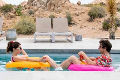 "Andy Samberg and Cristin Milioti co-star in Hulu's new infinite time loop movie ""Palm Springs."""