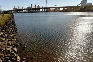 File photo taken Thursday, Oct. 25, 2018, shwoing the Mill River in New Haven, Conn., toward the Interstate 95 Pearl Harbor Memorial Bridge. The sewage leak on July 7, 2020, was reported to be in the river near the Whitney Dam, Mayor Justin Elicker said.