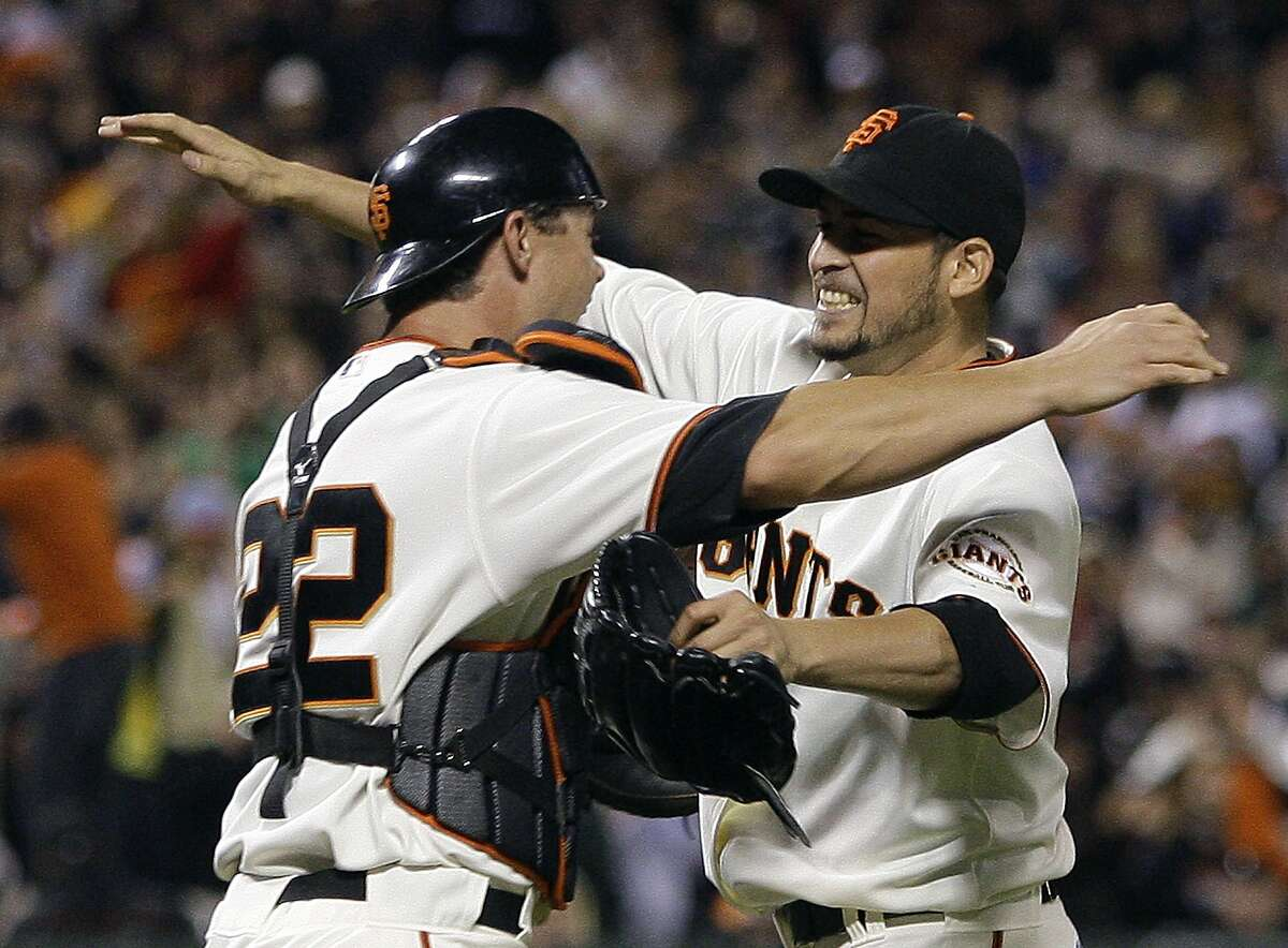 San Francisco Giants' Jonathan Sanchez, right, is embraced by catcher Eli Whiteside at the end of a baseball game after pitching a no hitter against the San Diego Padres Friday, July 10, 2009, in San Francisco. (AP Photo/Ben Margot)