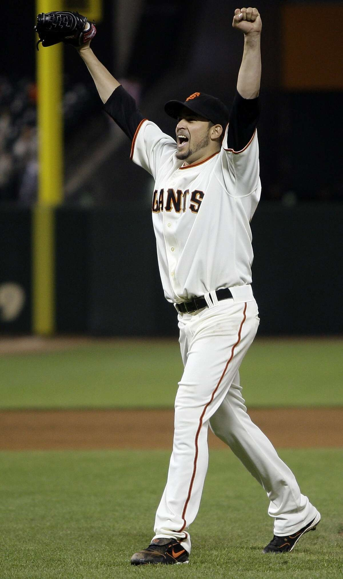 San Francisco Giants' Jonathan Sanchez celebrates at the end of a baseball game after pitching a no-hitter against the San Diego Padres Friday, July 10, 2009, in San Francisco. Sanchez pitched the majors' first no-hitter this season Friday night, dominating the San Diego Padres with an array of pitches in the San Francisco Giants' 8-0 victory. Sanchez finished with 11 strikeouts and no walks. (AP Photo/Ben Margot)