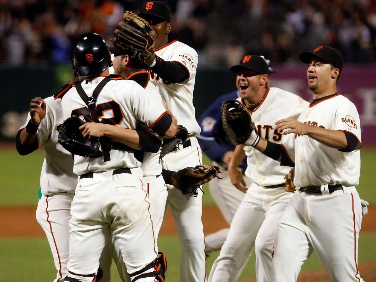 Jonathan Sanchez is mobbed by his teammates after he pitched a no-hitter at AT&T Park in San Francisco, Calif., on Friday, July 10, 2009.