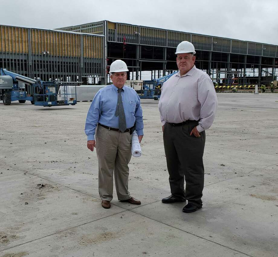 Cibolo Economic Development Corporation executive director Mark Luft, left, joins EDC Board President Robert Theis at the AW Texas site in Cibolo during one of Luft's final days with the city before his retirement. Photo: Jeff B. Flinn /Staff