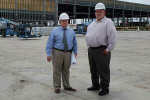 Cibolo Economic Development Corporation executive director Mark Luft, left, joins EDC Board President Robert Theis at the AW Texas site in Cibolo during one of Luft's final days with the city before his retirement.