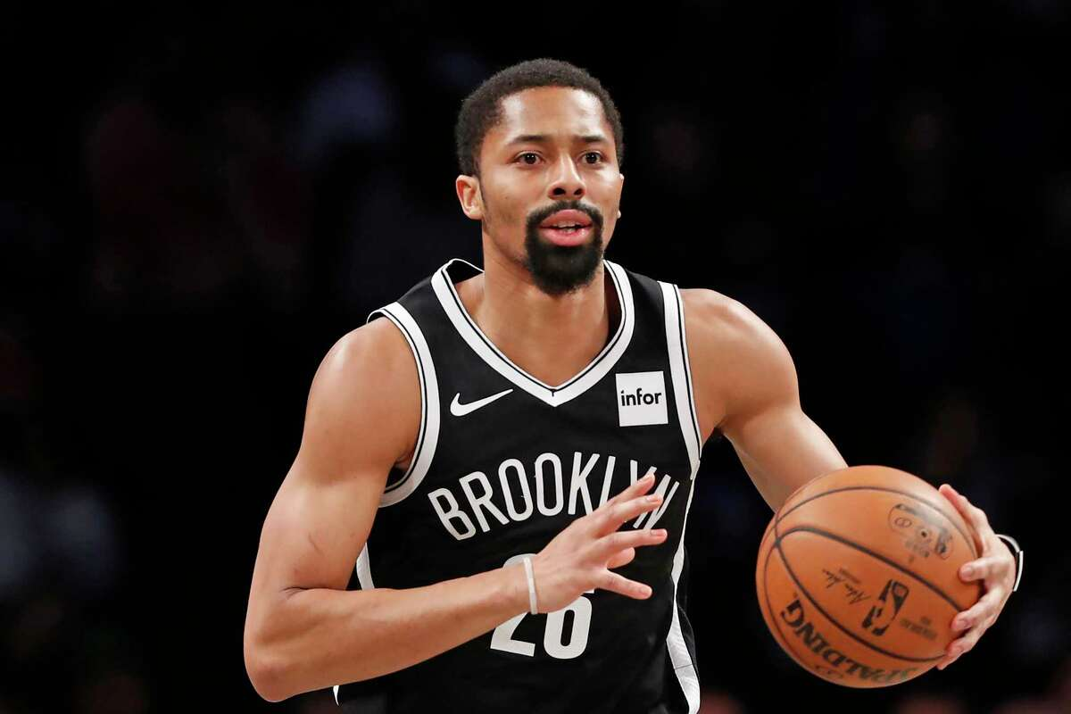 FILE - In this March 4, 2020, file photo, Brooklyn Nets guard Spencer Dinwiddie (26) is shown during the first quarter of an NBA basketball game in New York. Dinwiddie wona€™t take part in the restart of the NBA season. Dinwiddie announced that he is still testing positive for coronavirus and won't participate.(AP Photo/Kathy Willens, FIle)