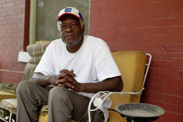 """Gerald Armstrong recalls his time working for the old Kansas City Athletics as an attendant and ball boy in the visitor's clubhouse as he speaks from the front porch of the home where he grew up and now lives in Kansas City, Mo., on Friday, June 26, 2020. Armstrong is one of more than a dozen Black men who said they were sexually molested by former Red Sox clubhouse manager Donald """"Fitzy"""" Fitzpatrick when they were youths. (AP Photo/Charlie Riedel)"""