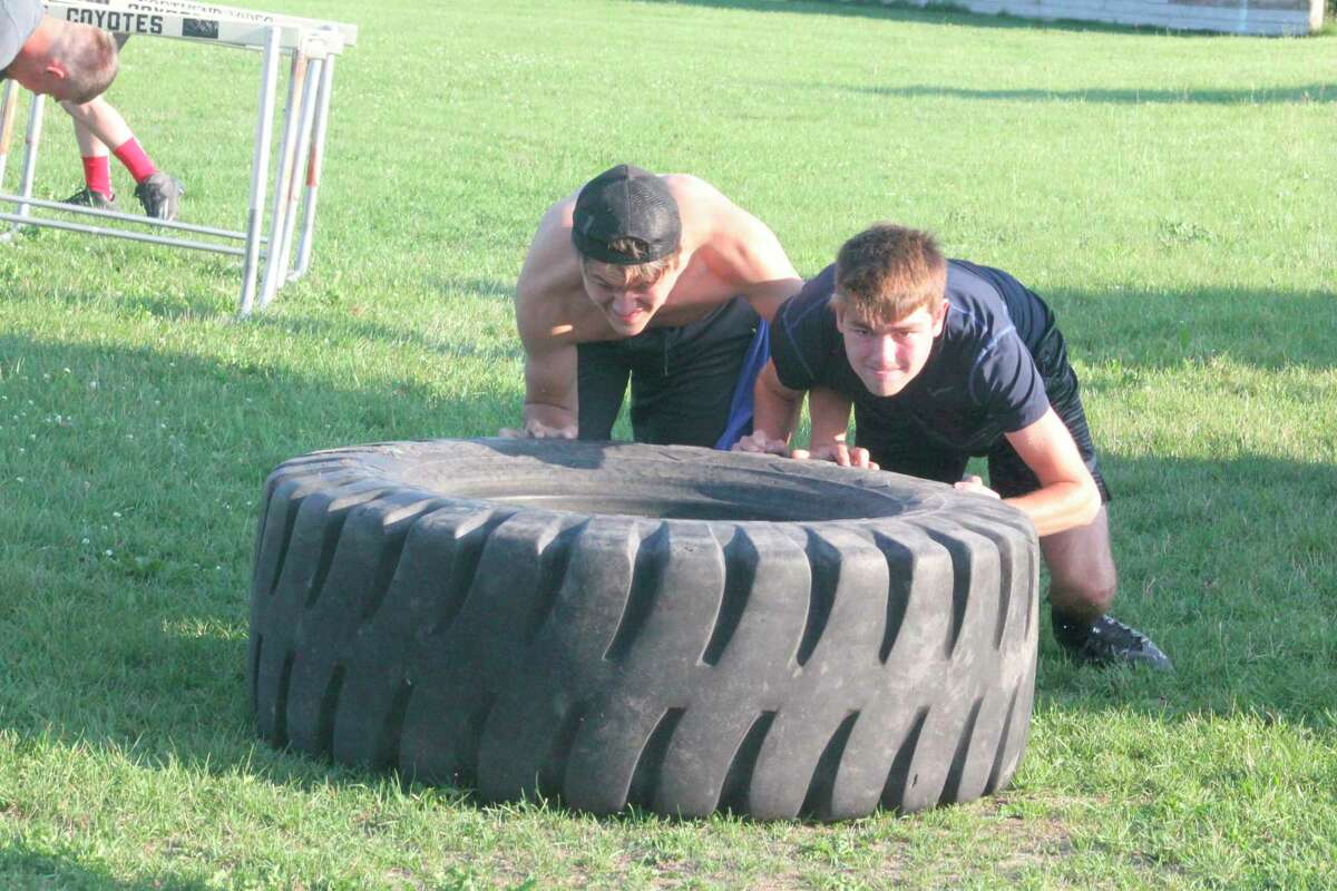 Reed City football players continue to pull and push tires as part of their preseason workouts. (Herald Review file photo)
