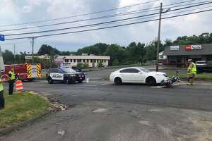 First responders at the scene of a car vs. motorcycle crash on Route 6 in Bethel, Conn., July 6, 2020.