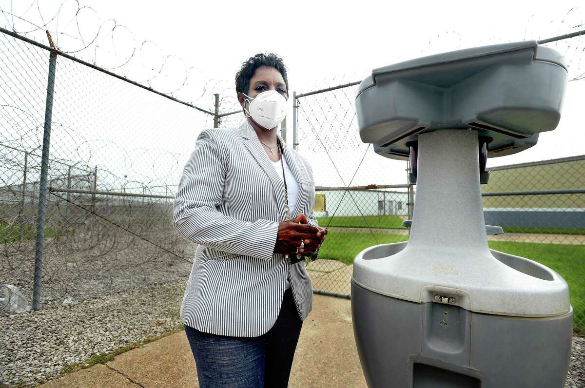 Sheriff Zena Stephens stands outside the main entry inside the Jefferson County Jail. A sanitizing station is placed outside the gate for employees to use upon entering or exiting the unit. It is one of several that are situated throughout the grounds and inside dorms and common areas at the correctional facility, where 60 of the nearly 700 inmates and more than a dozen employees have tested positive for COVID-19 recently. Empty dorms are being prepared to be used as shelter for those who are positive, and mass testing is underway for those housed at the site. Photo taken Tuesday, July 7, 2020 Kim Brent/The Enterprise