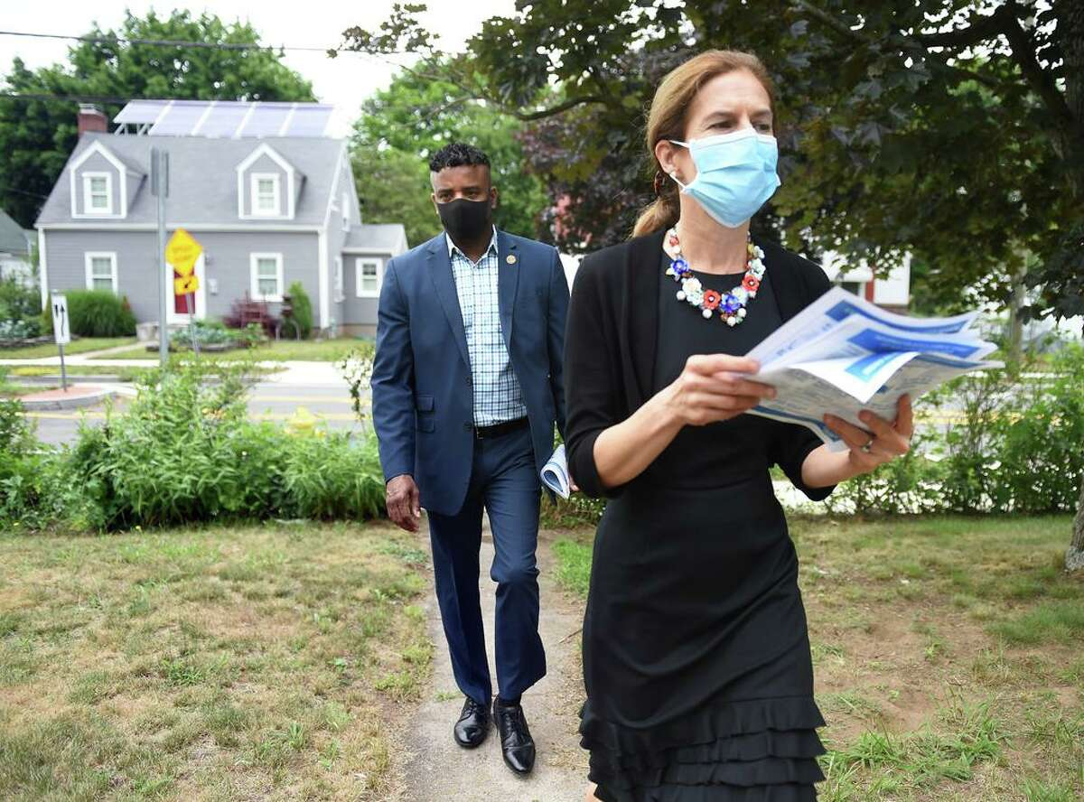 New Haven Aldermanic Majority Leader Richard Furlow (left) and Lt. Governor Susan Bysiewicz distribute 2020 Census forms to residents of Ramsdell Street in New Haven on July 7, 2020.