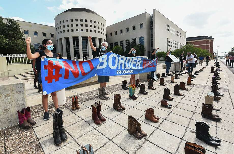 Boots and shoes of those that cannot be present are placed on the ground as the #NoBorderWall Laredo Coalition holds a demonstration outside the George P. Kazen Federal Building and United States Courthouse, Tuesday, July 7, 2020, to protest the building of a border wall in Laredo. Photo: Danny Zaragoza /Laredo Morning Times