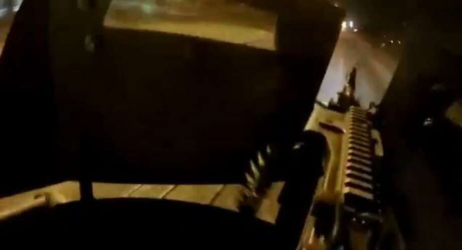 A gun turret is pictured on top of a soldier's vehicle during an attack last week where 16 cartel members were killed. Photo: Screencapture