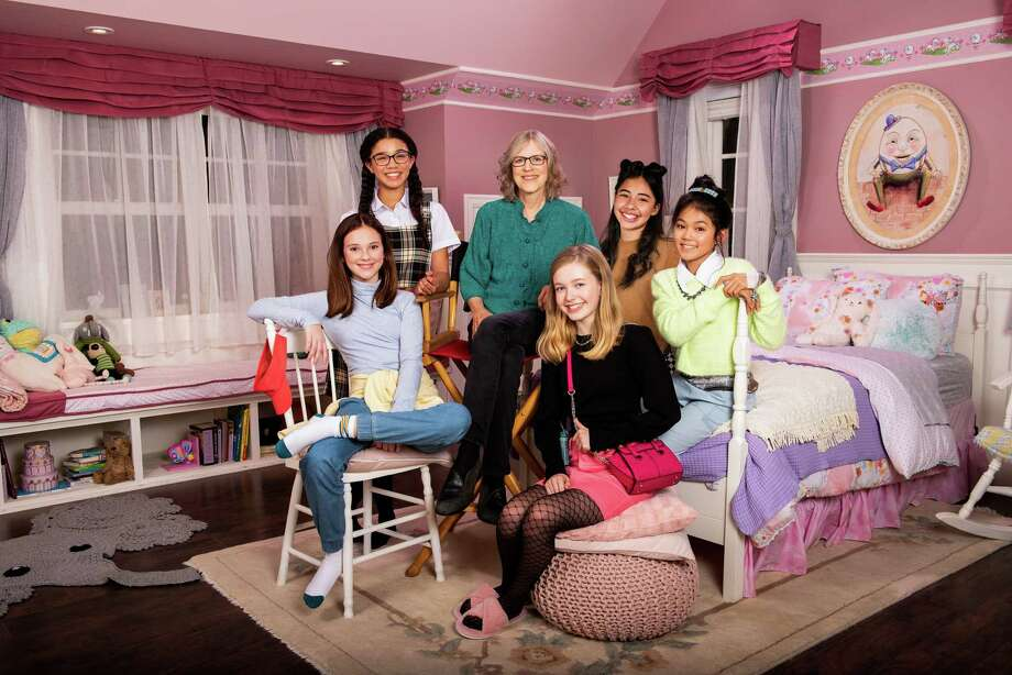 "From left, ""The Baby-Sitters Club"" teen cast members Sophie Grace (Kristy), Malia Baker (Mary Anne), Shay Rudolph (Stacey), Xochitl Gomez (Dawn) and Momona Tamada (Claudia) pose with original series author Ann M. Martin, center, on the set of the new Netflix show. Photo: Kailey Schwerman/Netflix / Netflix"