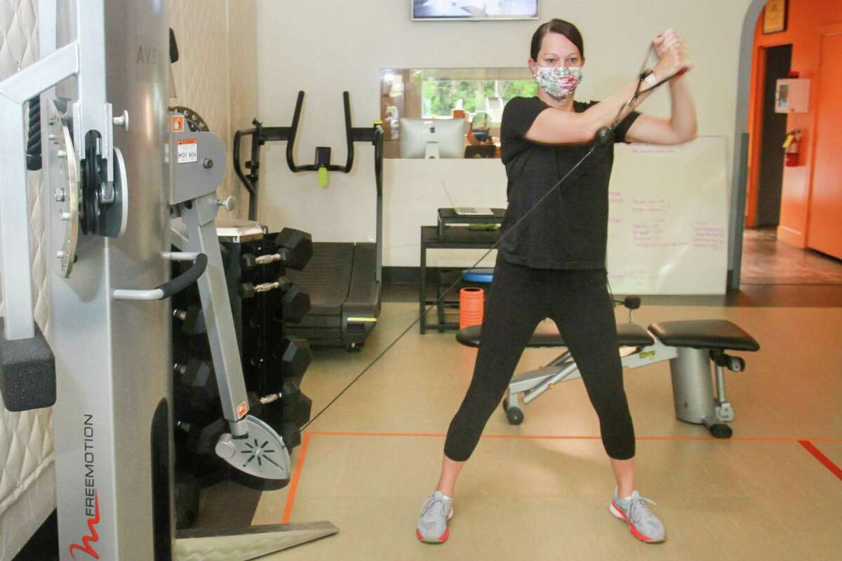 Jennifer Girotto working out at Avenu Fitness in Houston on July 2, 2020. Avenu Fitness has mandated all clients and instructors wear face masks the entire time they're in the facility, including when they're exercising.