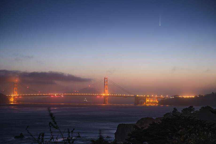 Comet Neowise is viewable by the naked eye in the early morning above the Golden Gate Bridge looking east from San Francisco, Calif. on July 8, 2020. Photo: Moshen Chan