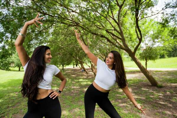 T2 Dance Company co-founders Sonali Patel, 35, and Anisha Gupta, 32, at Spotts Park on Friday, July 3, 2020, in Houston. The T2 Dance Company is conducting free Zoom Bollywood Dance classes for adults and kids to help lift spirits for those suffering from social withdrawal due to COVID-19.