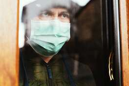 A man confined at home during the coronavirus global pandemic
