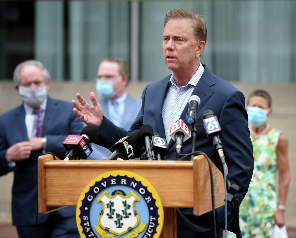 Gov. Ned Lamont speaks at a news conference in July.