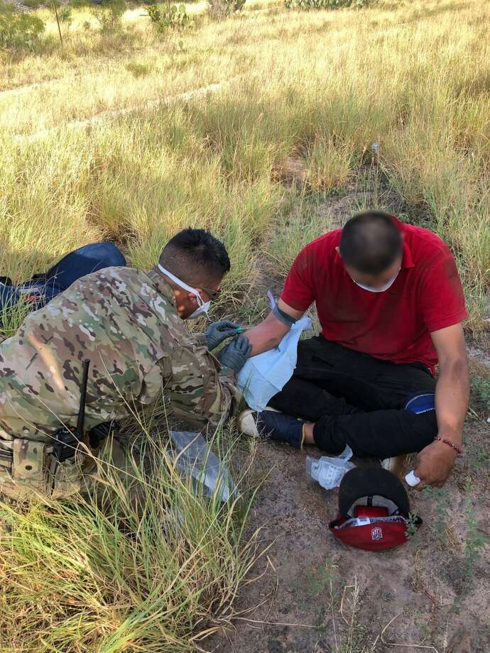 Individuals are pictured receiving treatment after being found by the US Border Patrol over the holiday weekend attempting to cross the border illegally. Photo: Courtesy