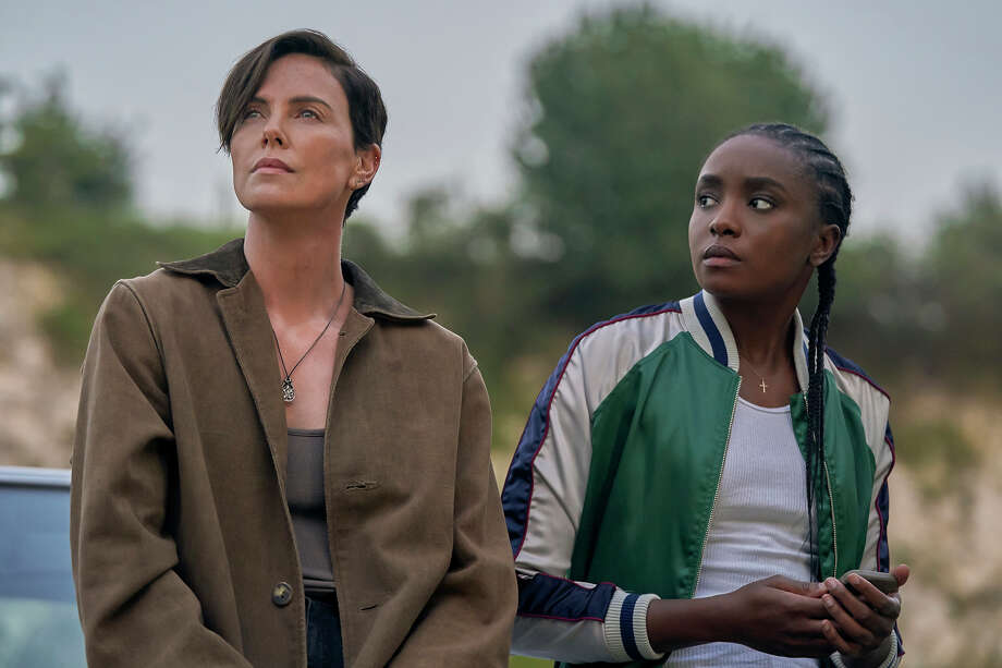 """Charlize Theron, left, and KiKi Layne in """"The Old Guard."""" Photo: Aimee Spinks/Netflix / © 2020 Netflix, Inc."""