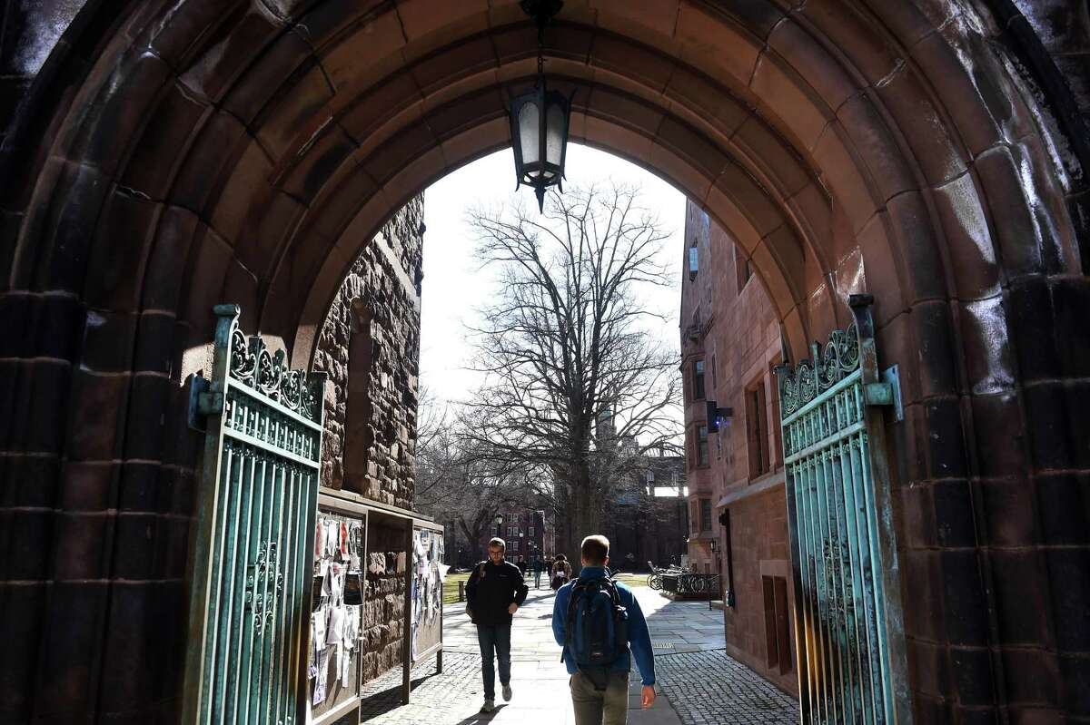 Students walk through an entrance to Yale University's Old Campus in New Haven on March 5.