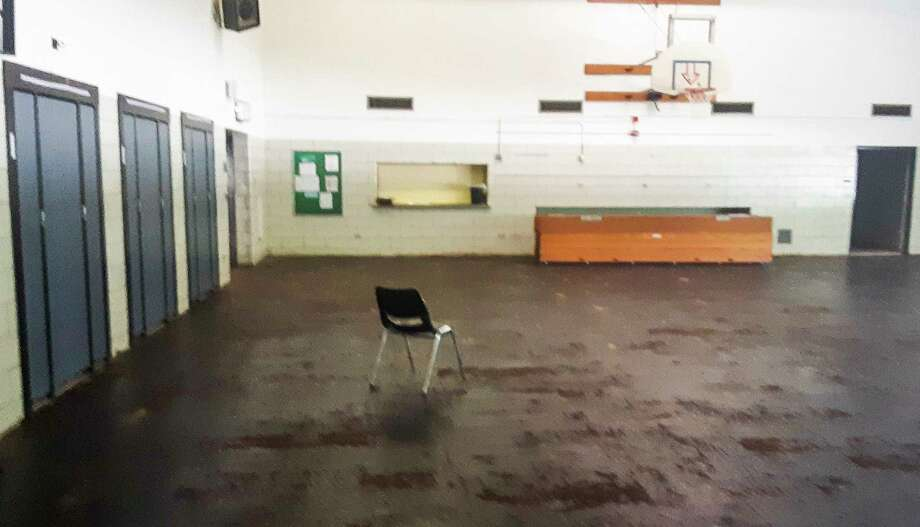 The wooden floor of the Windover High School gym was ruined by the flood in May and had to be removed. The school is undergoing extensive repairs in hopes of being open for the first day of the fall semester on Aug. 31. (Dan Chalk/chalk@mdn.net)